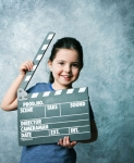 Childwithclapboard